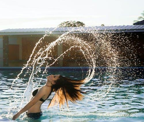 Kostenloses Stock Foto zu baden, frau, langzeitbelichtung, person