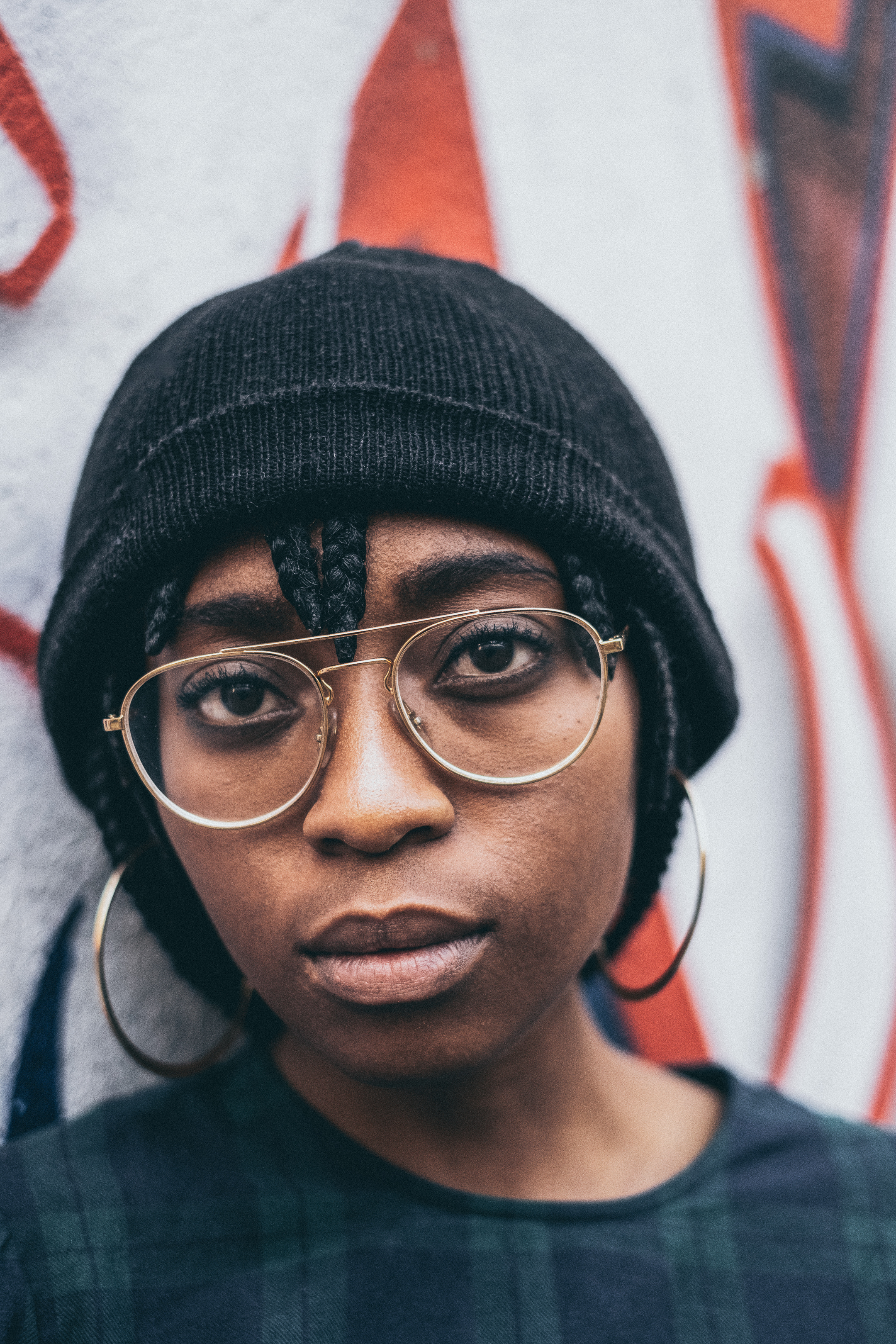 Close-Up Photo Of Woman Wearing A Beanie And Eyeglasses