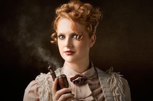 Woman Holding Smoking Pipe
