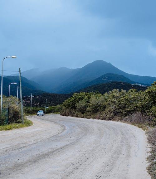 Základová fotografie zdarma na téma auto, dopravní systém, hora, krajina