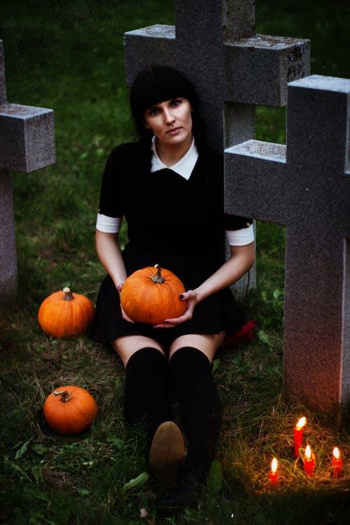 Woman sitting holding pumpkin