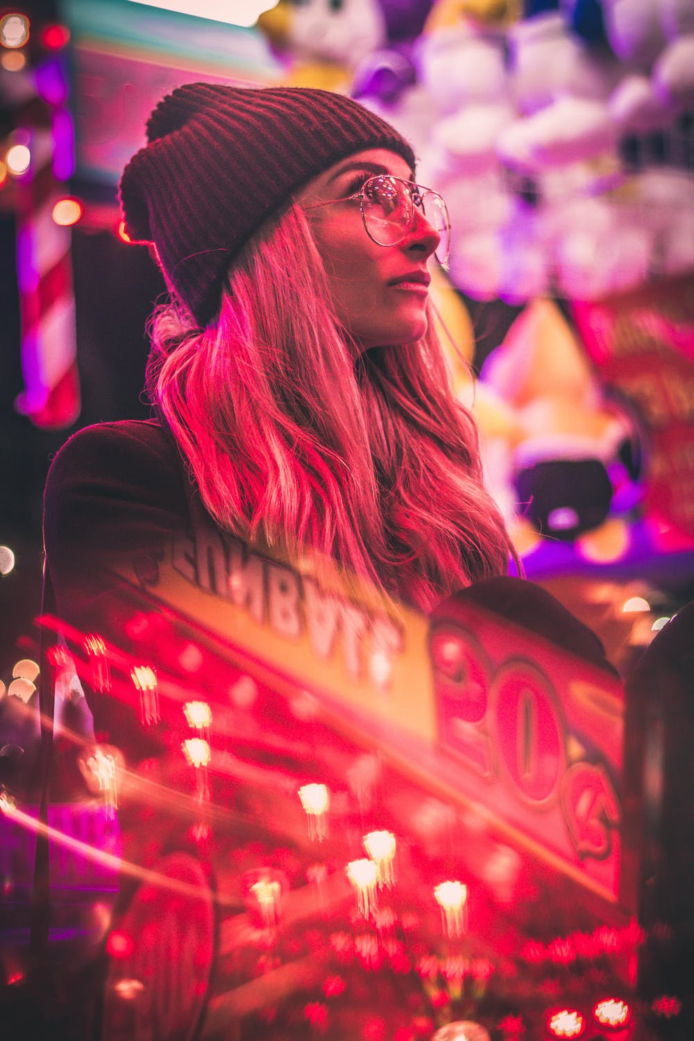 Woman wearing black knit cap and eyeglasses. | Photo: Pexels