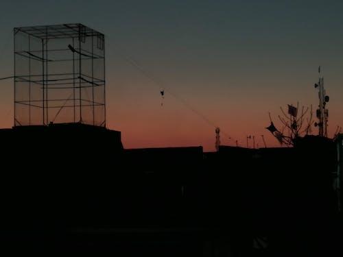 Free stock photo of beautiful sunset, bird cage, signal tower