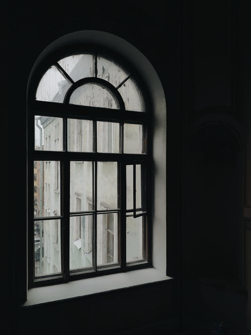 Arched Glass Window With Dark Background
