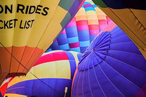Close-up Of Inflated Multi-Colored Hot Air Balloons