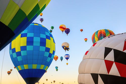 Low Angle Shot Of Airborne Multi-Colored  Hot Air Balloons