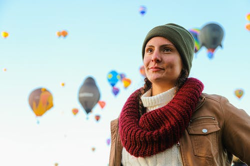 Woman Wearing Green Beanie And Knitted Scarf