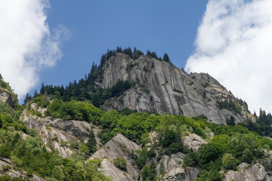 cliff, clouds, conifers