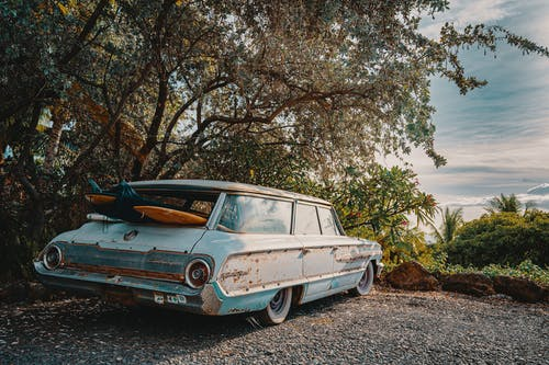 Surfboards Inside Vintage Light Blue Station Wagon