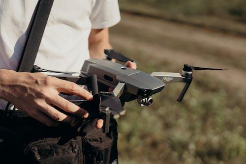 Person Holding Dji Mavic Drone