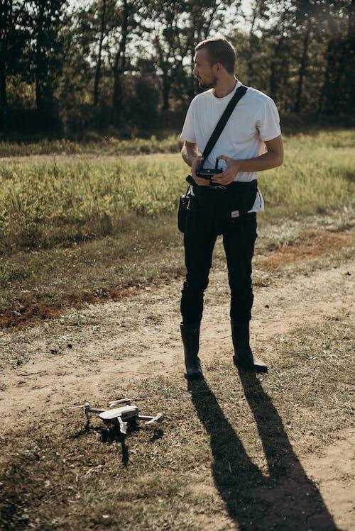 Безкоштовне стокове фото на тему «drone камери, дрон, камера, людина»