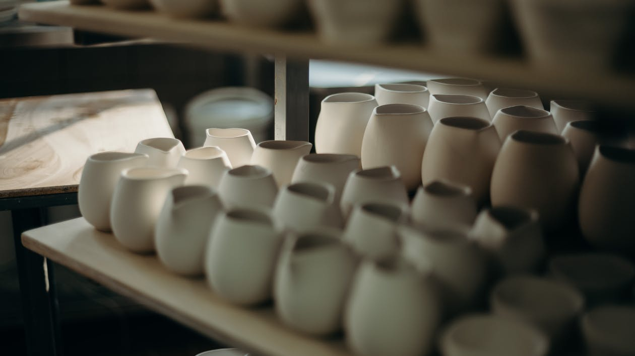 Photo Of Pots On Shelves