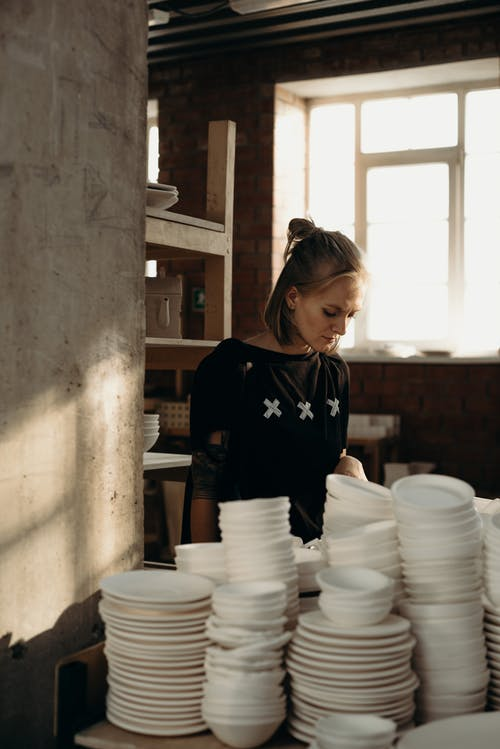 Photo Of Woman Looking On Kitchenware