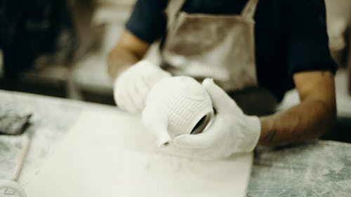 Photo Of Person Making Tea Pot