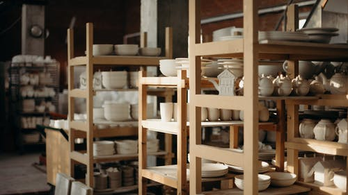 Photo Of Ceramic Kitchenware On Shelves