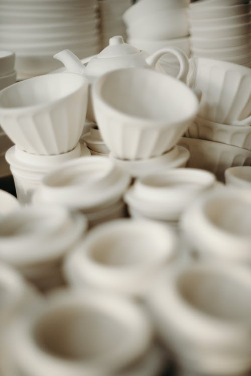 Selective Focus Photo Of White Ceramic Cups