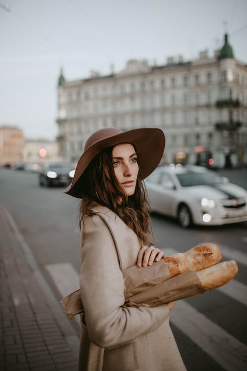 Woman Holding Baguettes