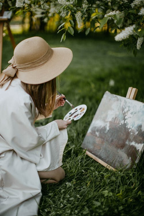 Woman Painting Outdoors