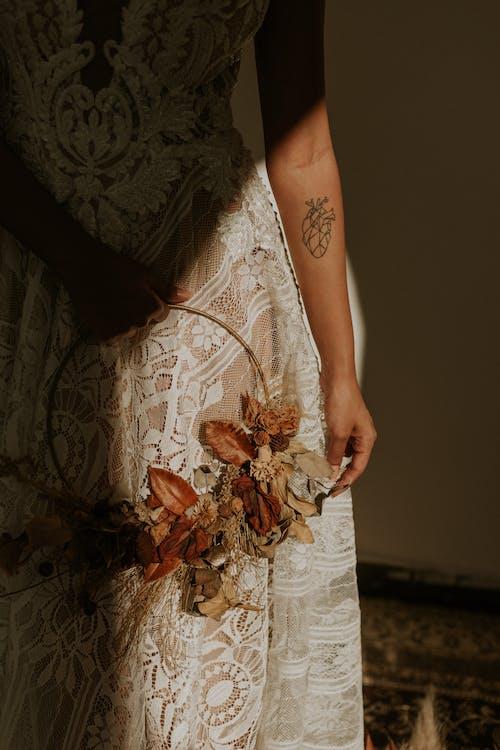 Woman Wearing White Lace Dress Holding Wreath