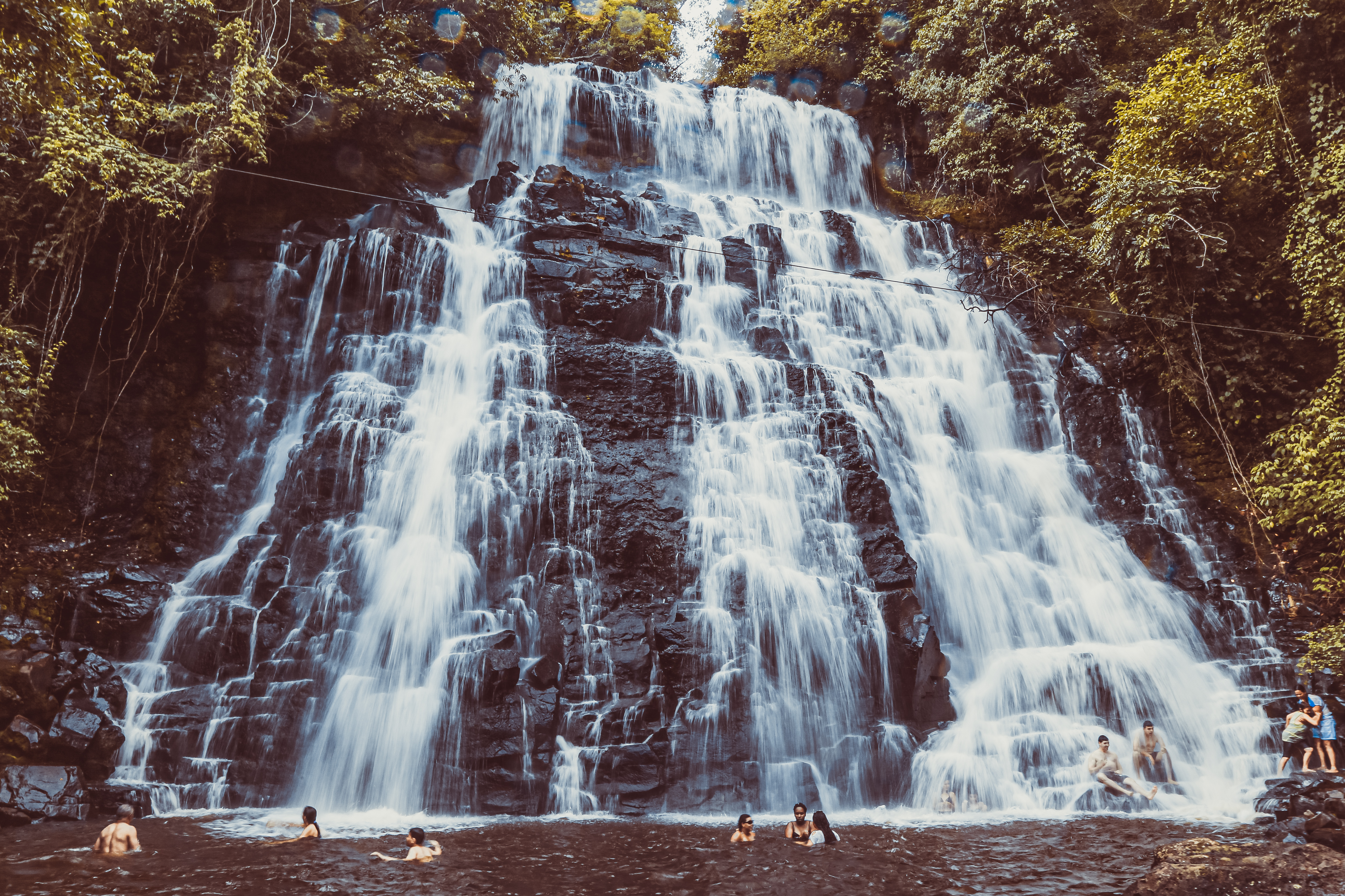 Time-Lapse Photography of People Near Waterfalls