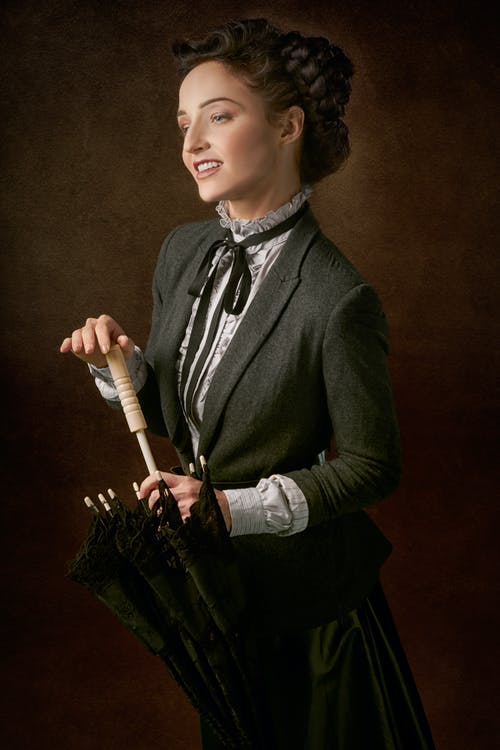 Woman Holding Cane Umbrella