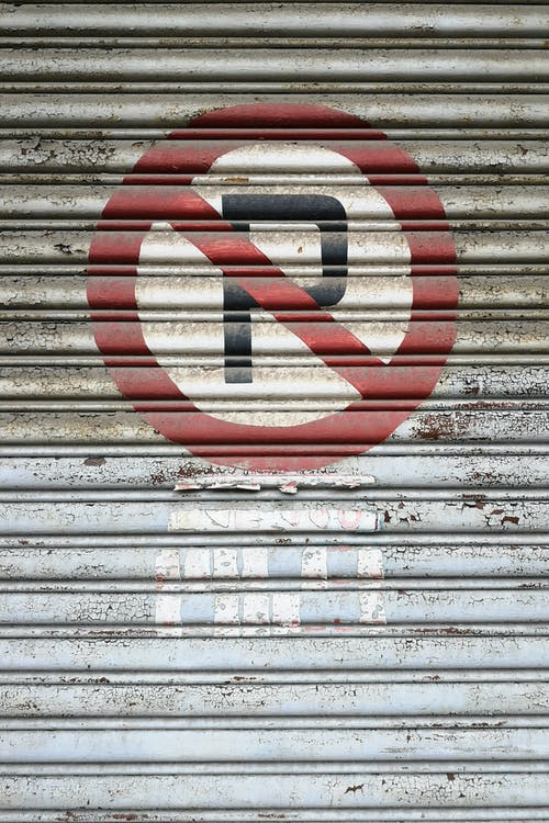 Photo of No Parking Sign on Roller Shutter
