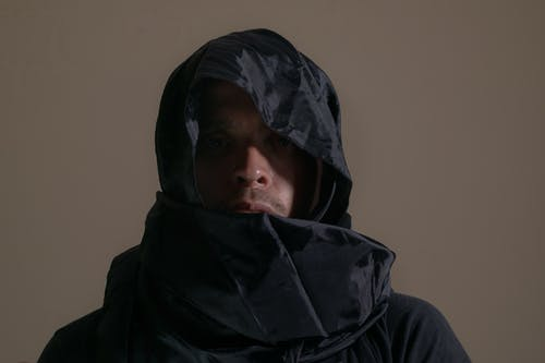 Photo of Person Covered With Black Veil
