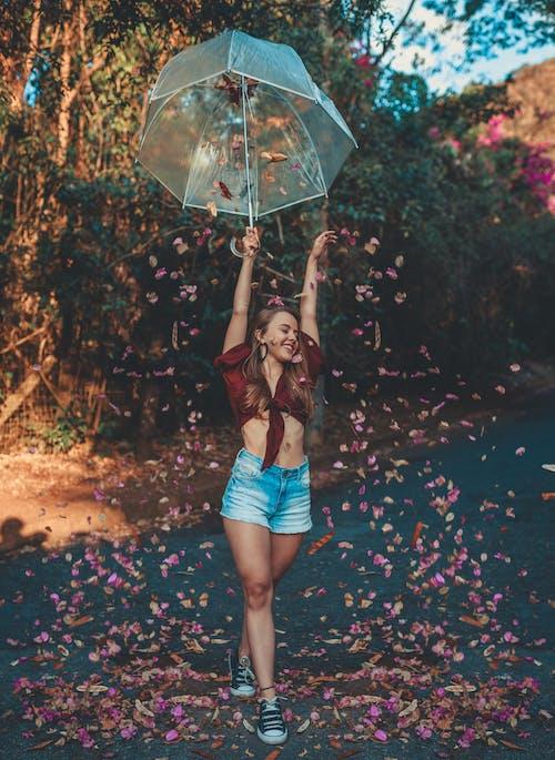 Photo of Woman Holding an Umbrella