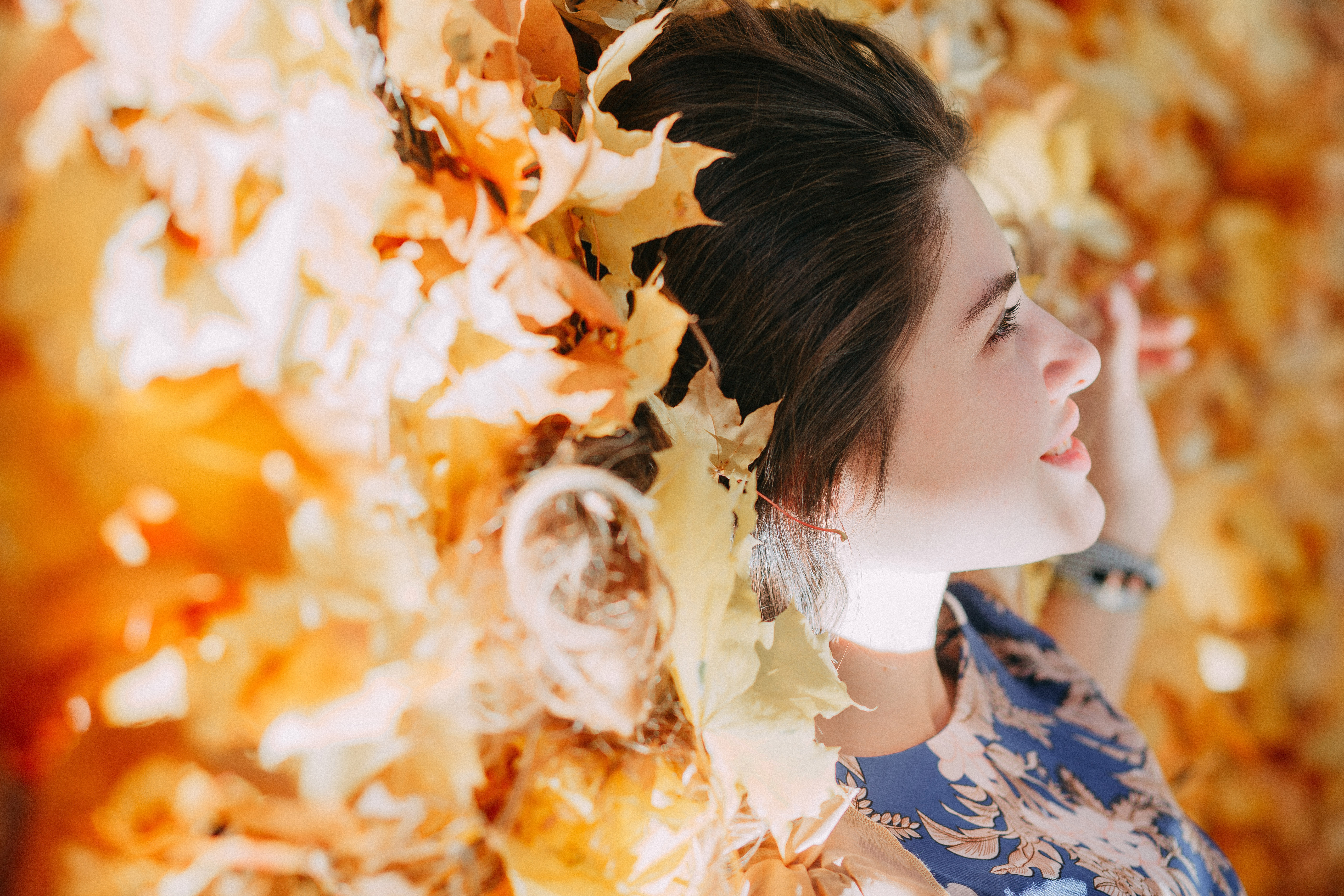 Selective Focus Photo of Woman Lying on Fallen Leaves