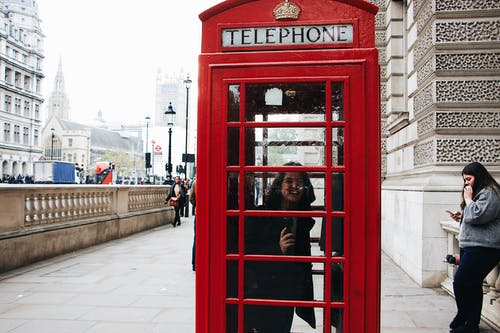 Photo of Woman Inside the Telephone Booth