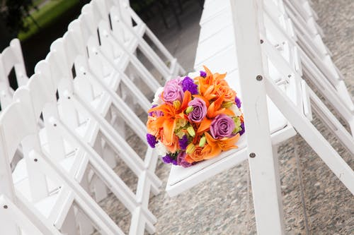 Free stock photo of flower bouquet, flowers, wedding bouquet, white chairs