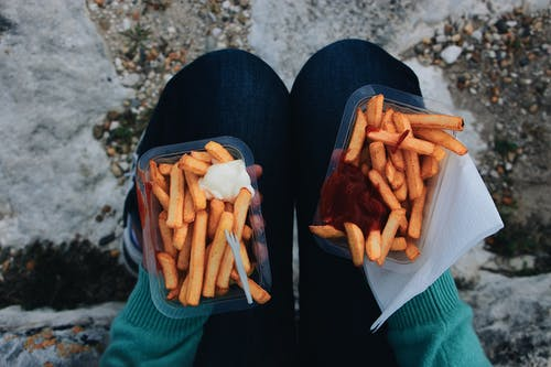 Photo Of Person Holding Fries