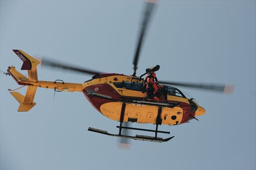 Low Angle Photo of Person on Helicopter