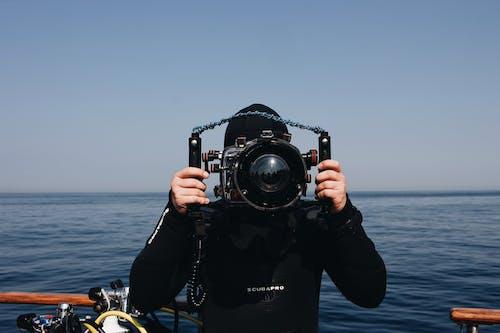 Man Holding Underwater Camera
