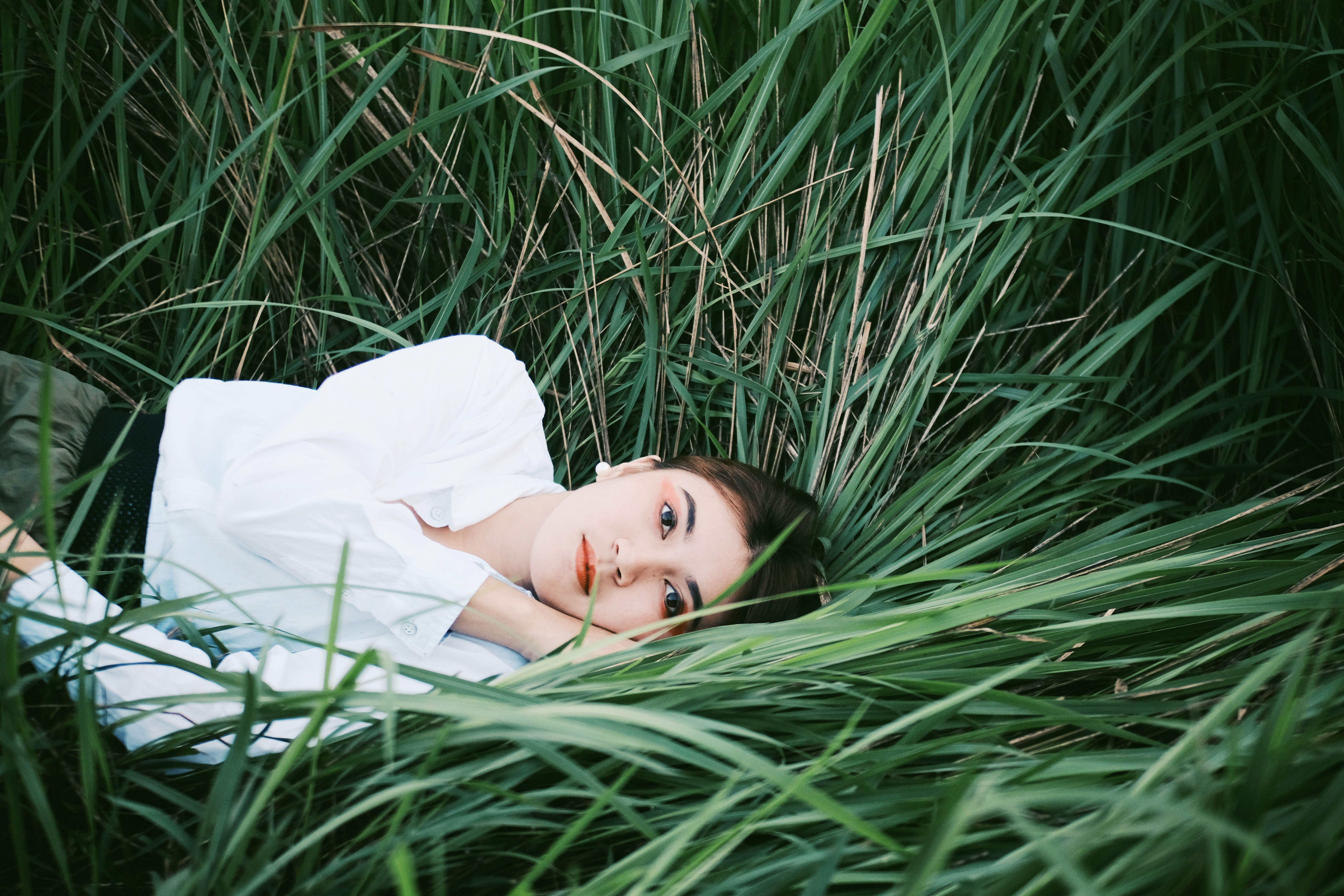 Woman Lying Down On Blades Of Grass Free Stock Photo