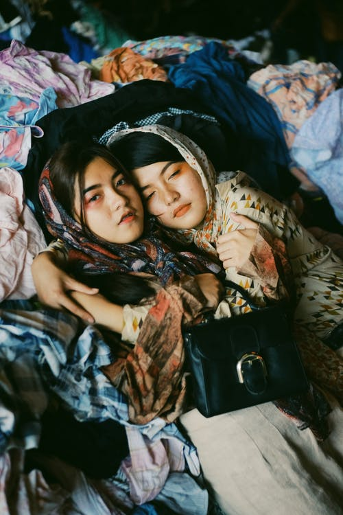 Girls Lying On Some Clothings