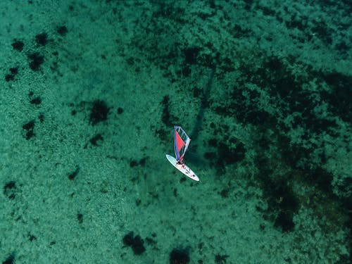 High Angle Photo of Sail Boat on Water