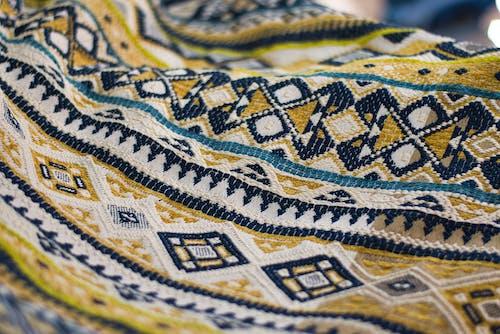 Yellow, White, And Black Textile