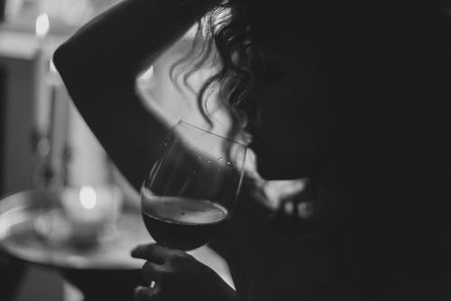 Monochrome Photo of Woman Holding Wine Glass