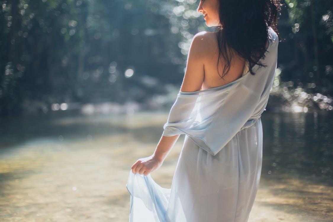 Woman Wearing White One-Shoulder Dress