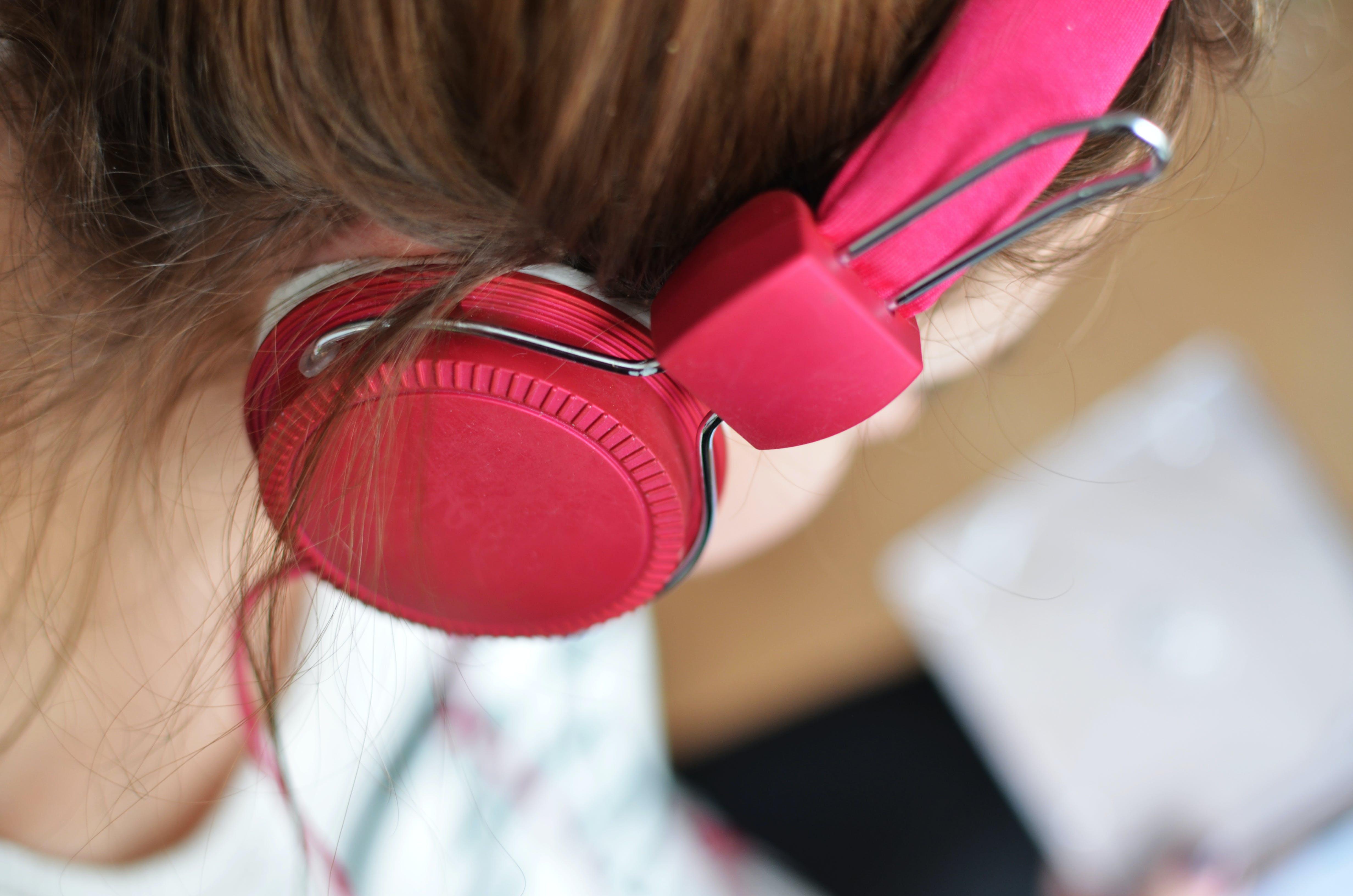 Woman Wearing Pink Headphones