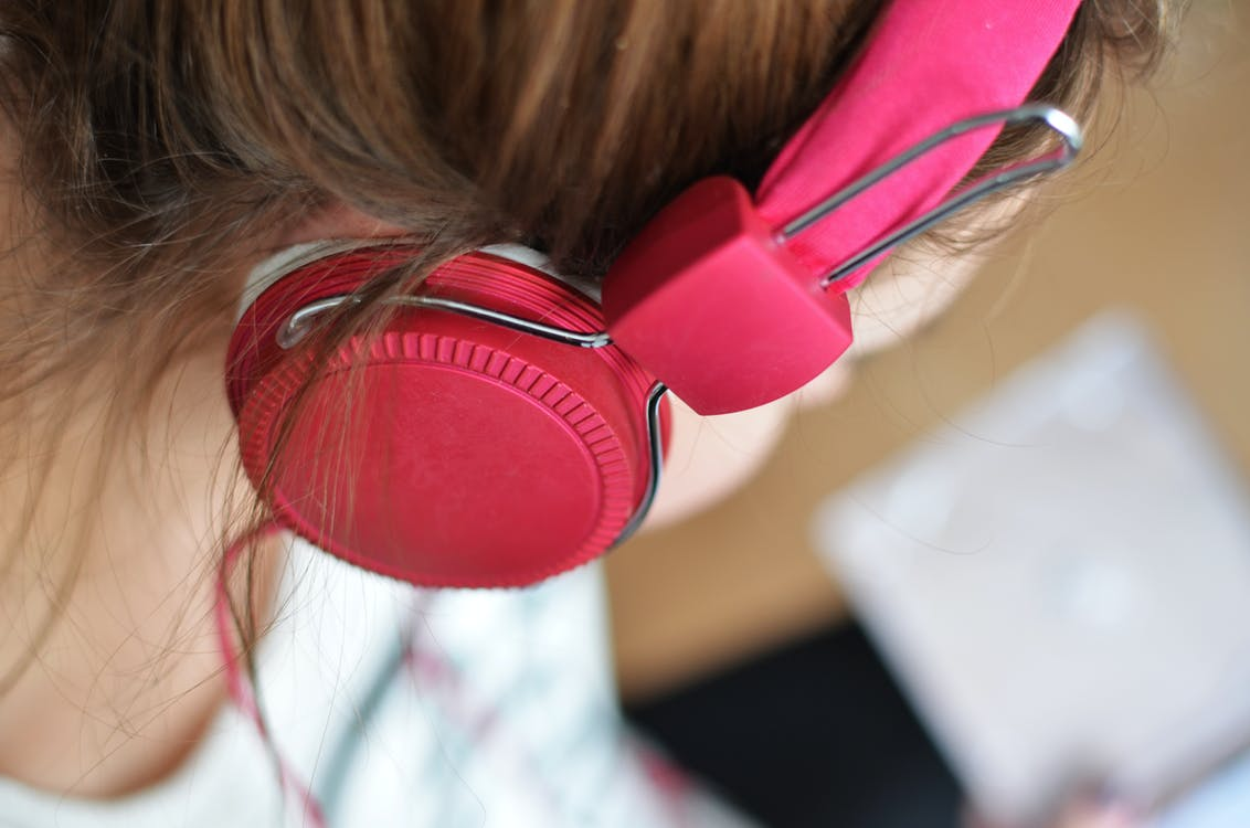 Woman Wearing Pink Headphones