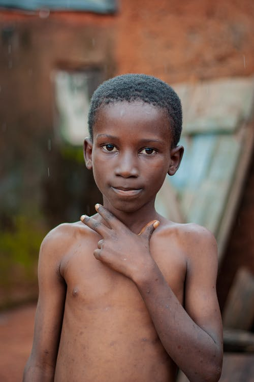 Shirtless Boy With Left Hand Under Chin