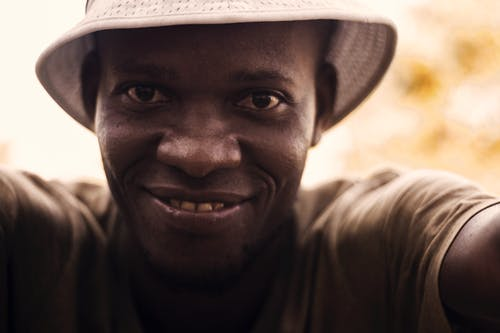 Free stock photo of african man, hat, smile