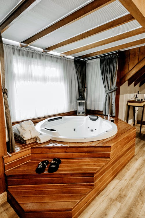 Brown Wooden Framed White Tub