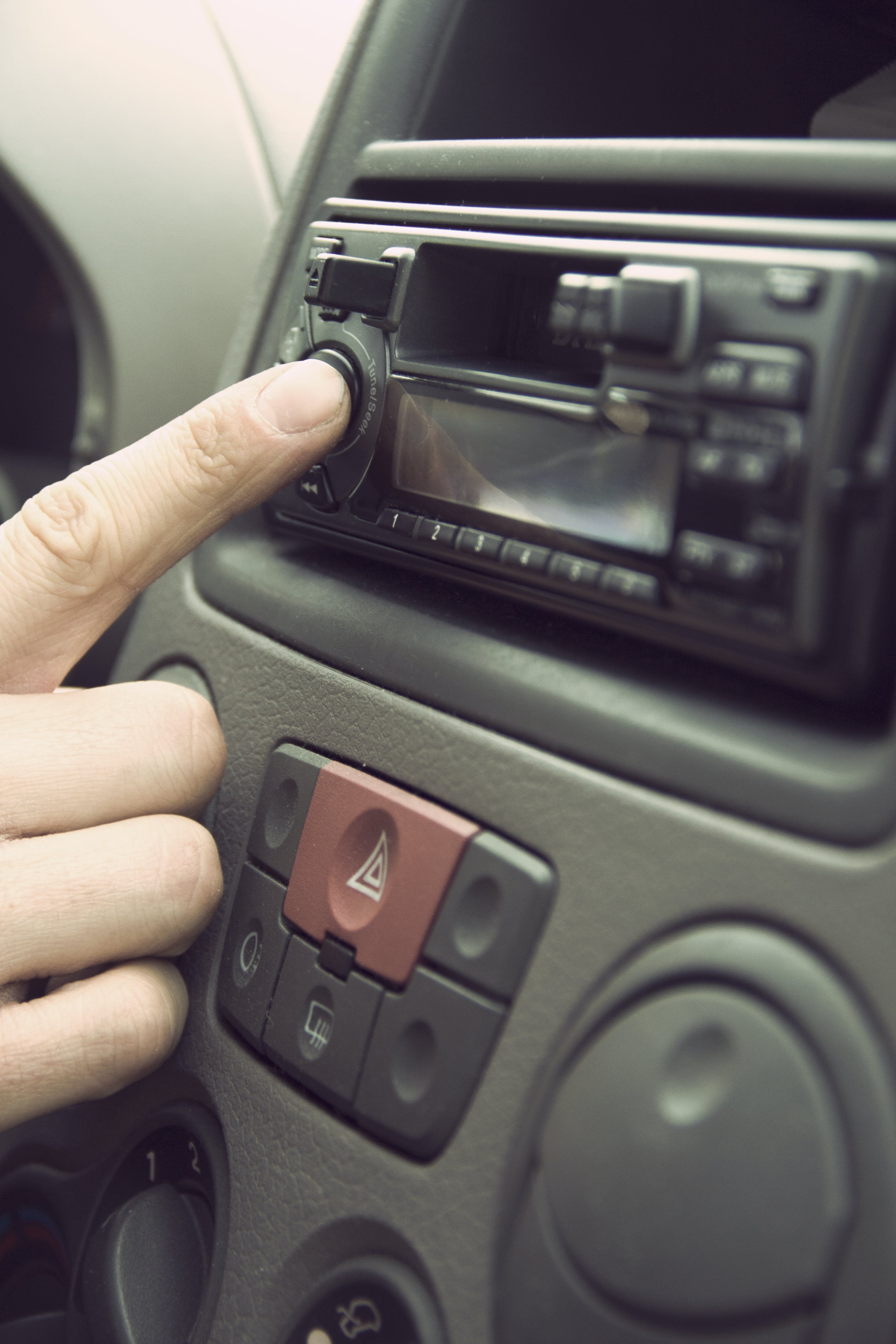 Person Touching 1-din Head Unit Button