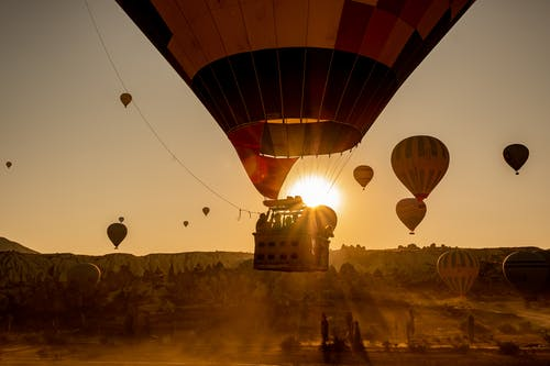 Hot Air Balloons in Mid Air during Golden Hour