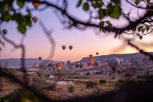 Бесплатное стоковое фото с вечер, вода, воздушные шары, восход