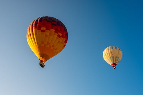 Red Yellow and Orange Hot Air Balloon in the Sky