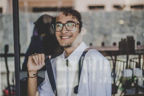 Photo Of Man Wearing Black Eyeglasses